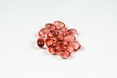 Grupp av klara röda mjuka gelatinkapslar Royaltyfria Foton