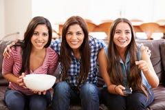 Grupp av kvinnor som sitter på Sofa Watching Sport Together Fotografering för Bildbyråer