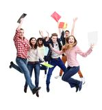 Grupp av lycklig ungdomar hoppa Arkivbilder