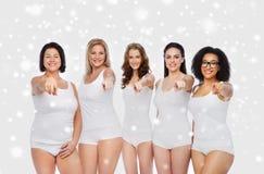 Grupp av lyckliga olika kvinnor som pekar på dig Royaltyfria Foton