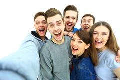 Grupp av lyckliga unga tonåringstudenter Arkivfoton