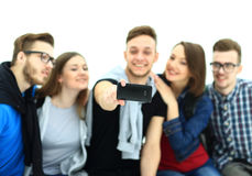 Grupp av lyckliga unga tonåringstudenter Royaltyfri Foto