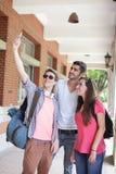 Grupp av lyckliga vänner som tar selfie Fotografering för Bildbyråer