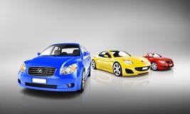 Grupp av mång- färgade moderna bilar Arkivfoto