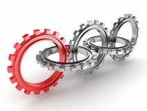 Grupp av metalliska kugghjul och en red Fotografering för Bildbyråer