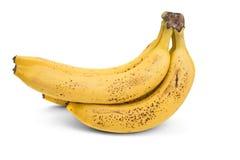 Grupp av mogna bananer med mörka fläckar Arkivbild