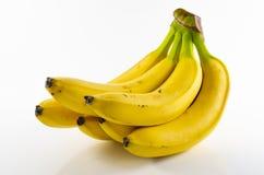 Grupp av mogna gula nya bananer arkivfoto