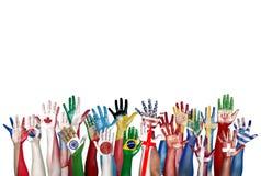 Grupp av olik flagga lyftta målade händer Royaltyfri Fotografi
