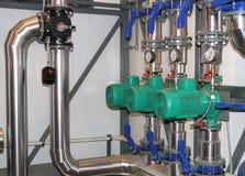 Grupp av pumpar i etthus Royaltyfri Bild