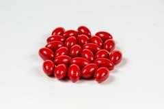 Grupp av röda mjuka gelatinkapslar Fotografering för Bildbyråer