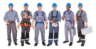 Grupp av rörmokaren med hjälpmedel Arkivfoton