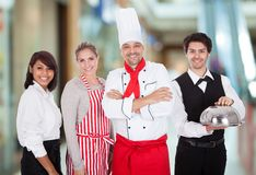 Grupp av restaurangpersonalen Arkivbilder