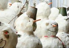 Grupp av snögubbear Fotografering för Bildbyråer