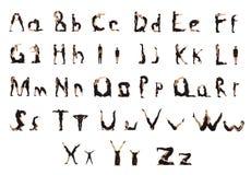 Grupp av svart klätt folk som bildar bokstäverna Arkivfoto