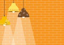 Grupp av taklampan på orange bakgrunder för tegelstenvägg Royaltyfri Fotografi