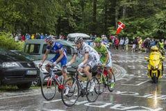 Grupp av tre cyklister Royaltyfri Bild