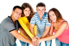 Grupp av ungdomar som rymmer händer Royaltyfria Bilder