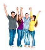 Grupp av ungdomar som rymmer händer Arkivfoto