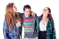 Grupp av ungt posera för vänner royaltyfri foto
