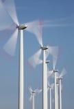 Grupp av windmills i rörelse Arkivfoton