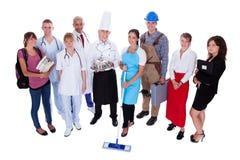Grupp människor som föreställer olika yrken Fotografering för Bildbyråer