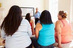 Gruppe übergewichtigen Menschen, die an Diät-Verein teilnehmen Lizenzfreie Stockfotos