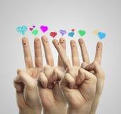Gruppe des Fingers mit Liebesinnerrede sprudelt Stockbild