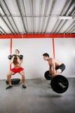 Gruppe des Trainierens mit zwei Leuten Lizenzfreies Stockfoto