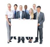 Gruppe Geschäftsleute, die Plakat halten Lizenzfreies Stockfoto
