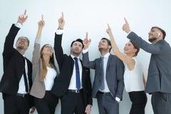 Gruppe Geschäftsleute, die sich an einem Kopienraum zeigen Stockbild