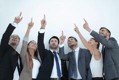 Gruppe Geschäftsleute, die sich an einem Kopienraum zeigen Lizenzfreies Stockbild