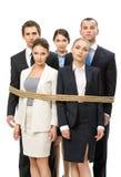 Gruppe Geschäftsleute gebunden mit Seil Lizenzfreie Stockfotografie