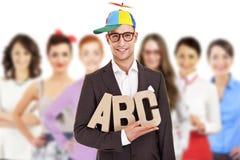 Gruppe Geschäftsleute mit Geschäftsmannführer im lustigen Hut Lizenzfreies Stockbild
