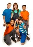 Verschiedenartigkeit 5, die glückliche Kinder schaut lizenzfreies stockbild