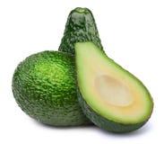 Gruppe grüne Avocados lokalisiert Lizenzfreies Stockfoto
