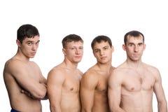 Gruppe junge Kerle mit muskulösen Karosserien stockfotos