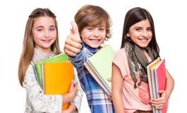 Gruppe kleine Studenten lizenzfreie stockfotos