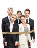 Gruppe Manager gebunden mit Seil Stockfotografie