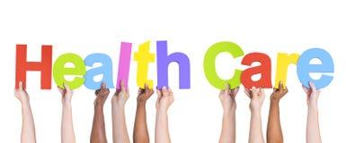 Gruppe multiethnische Hände, die Gesundheitswesen halten Lizenzfreies Stockfoto