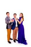 Gruppe von drei feiernden Freunden Stockbild