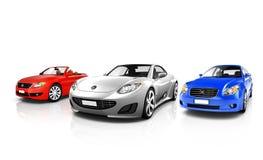 Gruppe von drei mehrfarbigen eleganten Autos Stockfotos