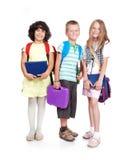 Gruppe von drei Schulkindern stockfoto