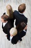 Gruppe Wirtschaftler in einem Kreis Lizenzfreies Stockfoto