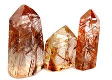 Gruppen av kvarts för tre mineral vaggar med rutilen som isoleras på en vit bakgrund Royaltyfria Bilder