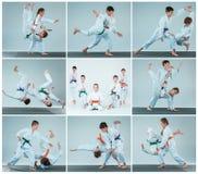 Gruppen av pojkar och flickastridighet på Aikidoutbildning i kampsportskola Sund livsstil och sportbegrepp arkivbilder