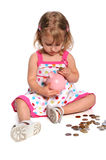 gruppen coins att sätta in för flicka som är piggy Royaltyfri Bild
