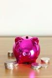 gruppen coins piggy silver fotografering för bildbyråer