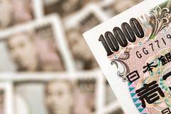 gruppjapanen bemärker yen Arkivfoto