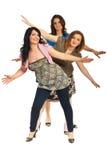 Gruppo allegro di donne con le mani in su Fotografie Stock