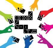 Gruppo che gioca con i domino Fotografie Stock Libere da Diritti